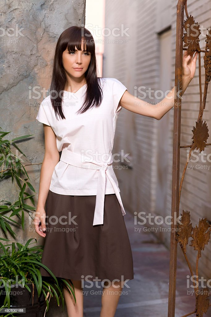 Beautiful Brunette Young Woman Fashion Model in Spring Clothing, Outdoors royalty-free stock photo