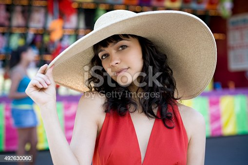 istock Beautiful Brunette Young Woman Fashion Model in Summer Hat, Carnival 492630060