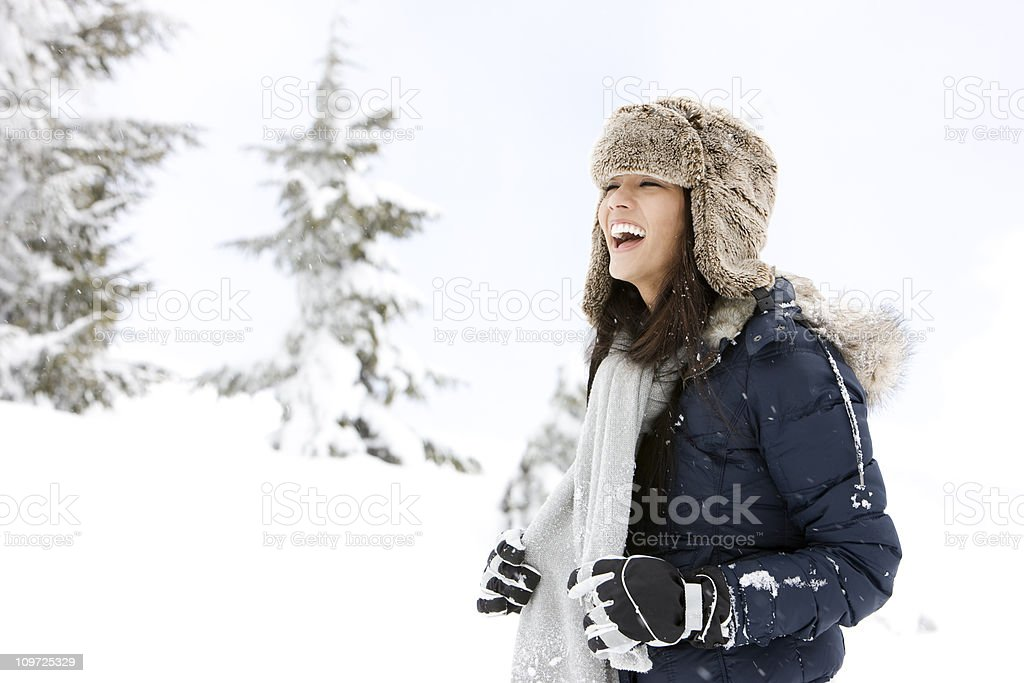 Beautiful Brunette Young Woman Having Fun in Snow, Copy Space stock photo