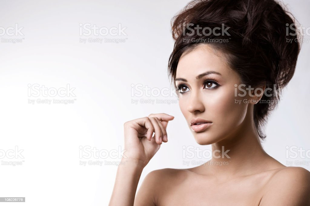 Beautiful Brunette Young Woman Head Shot on White, Copy Space royalty-free stock photo
