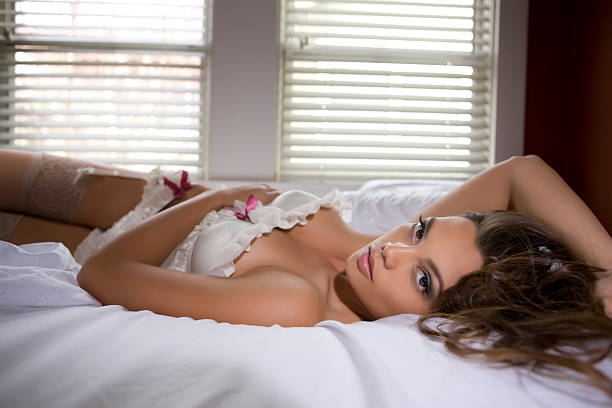 beautiful sexy young woman laying on bed in lingerie, copyspace - hawaiian ethnicity stock photos and pictures