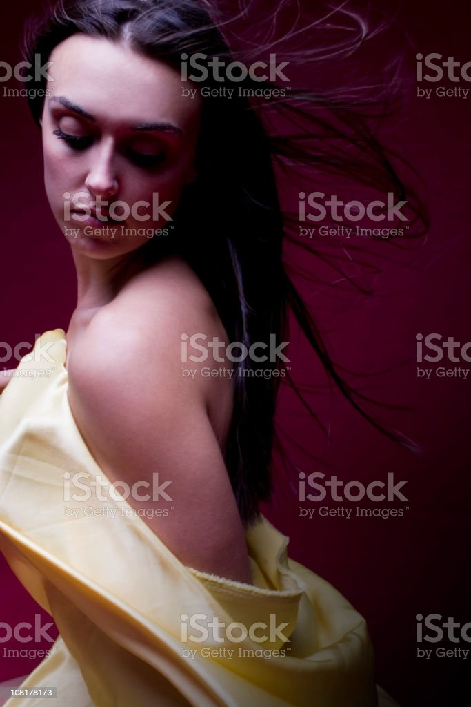 Beautiful Brunette Young Woman Portrait Wrapped in Yellow Silk royalty-free stock photo