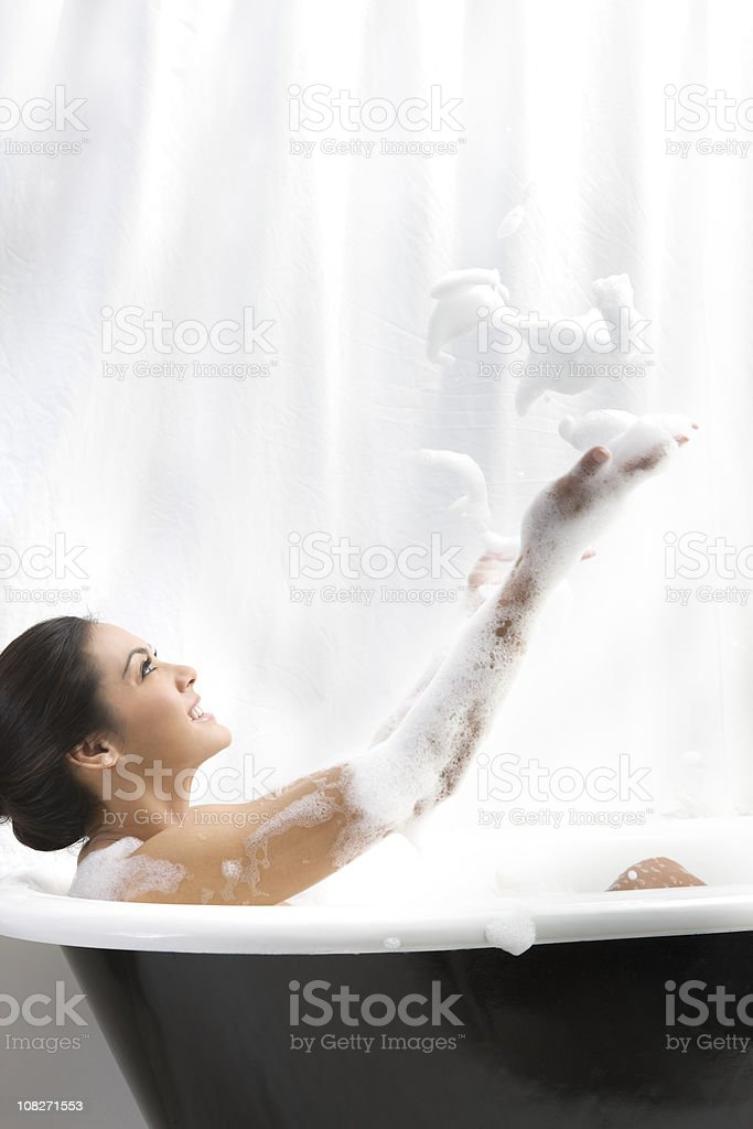Beautiful Brunette Young Woman Taking Bubble Bath, Copy Space royalty-free stock photo
