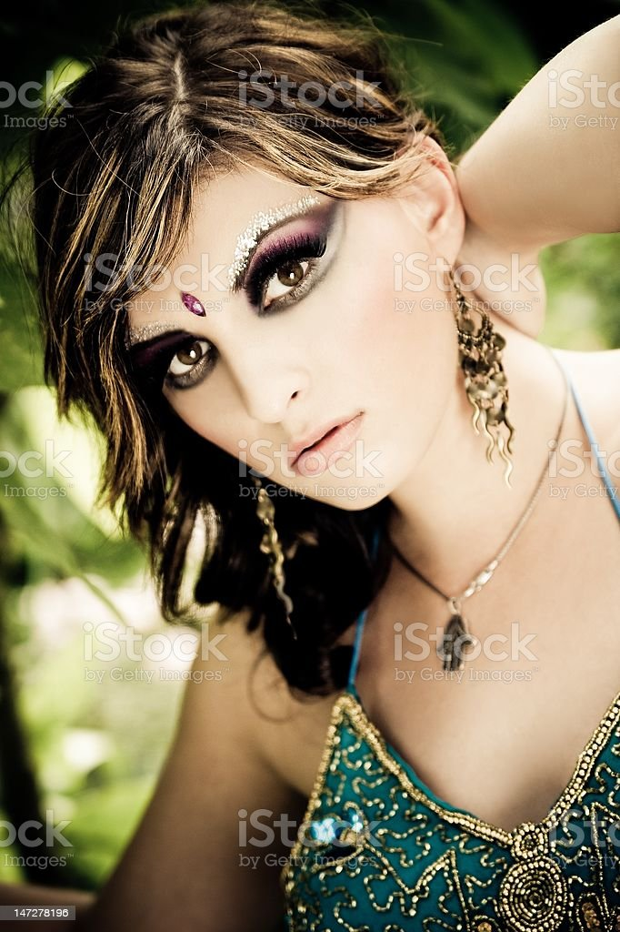 Beautiful brunette young woman with indian traditional fashion royalty-free stock photo