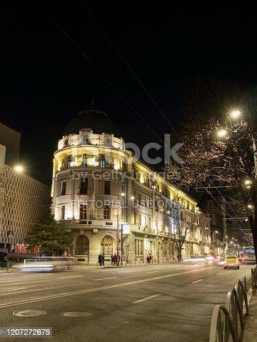 Bucharest, Romania - February 15, 2020: Beautiful building illuminated by night lights in Bucharest, Romania.
