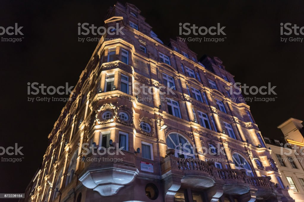 Beautiful buildings at Leicester Square in London at night stock photo