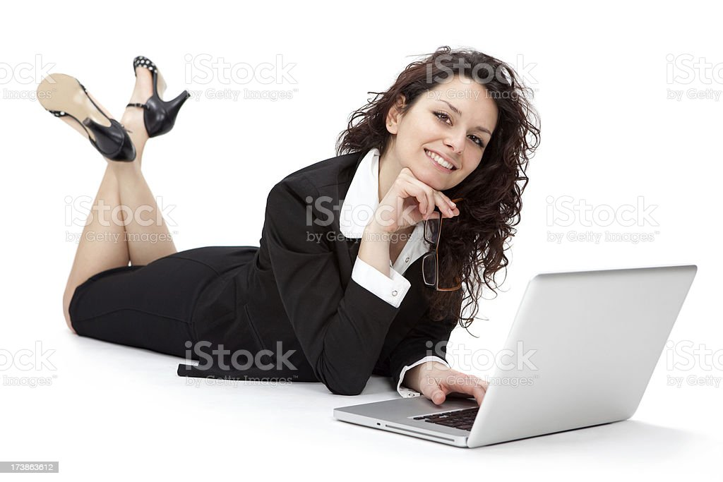 beautiful business girl lay working with laptop and smiling royalty-free stock photo