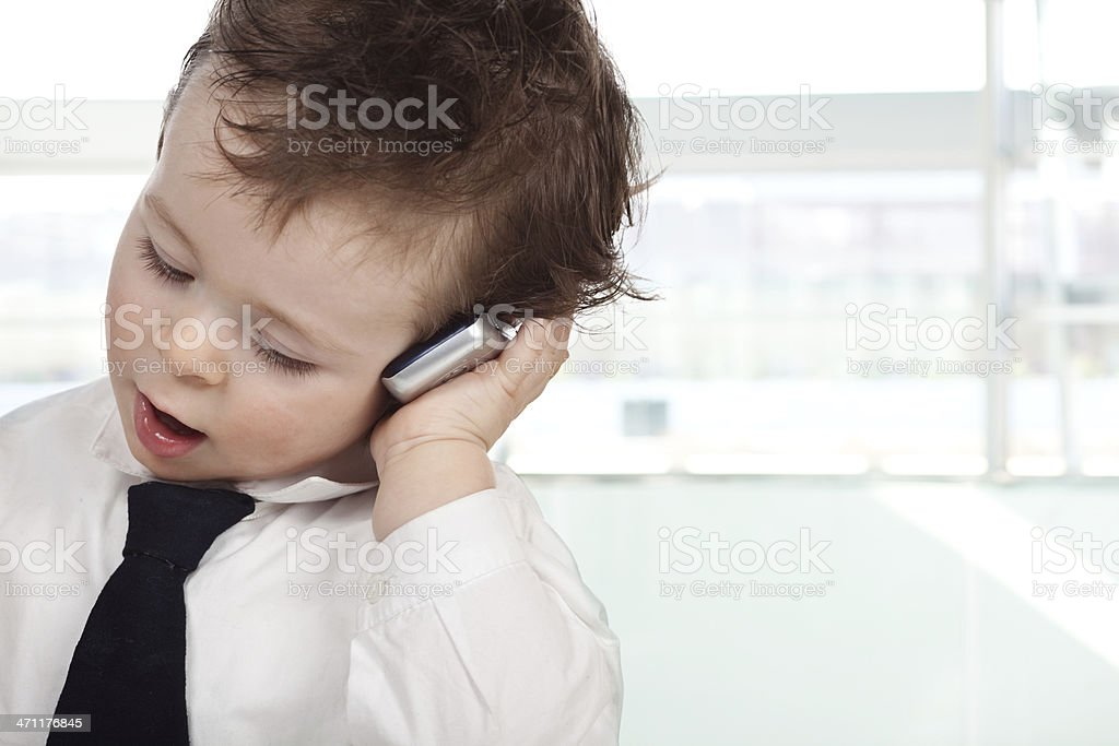 beautiful business kid use mobile phone royalty-free stock photo