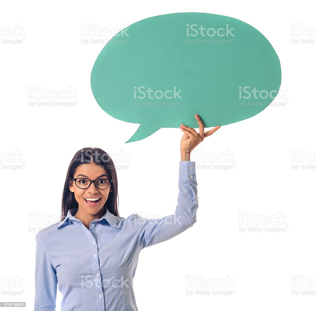Beautiful business lady with speech bubble stock photo
