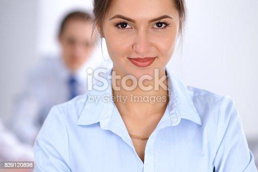 istock Beautiful business woman at meeting 839120898