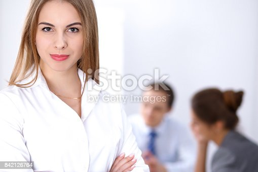 istock Beautiful business woman at meeting 842126764
