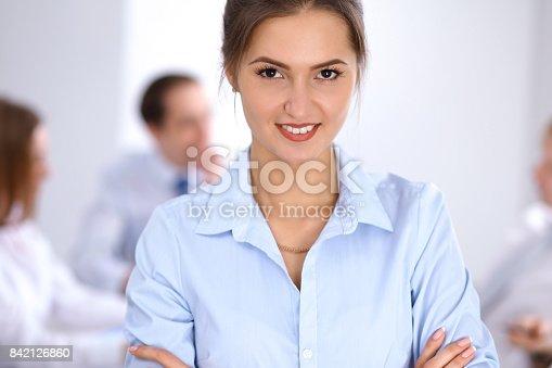 istock Beautiful business woman at meeting 842126860