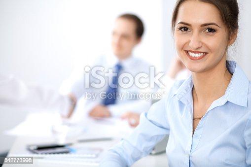 istock Beautiful business woman at meeting 842773998
