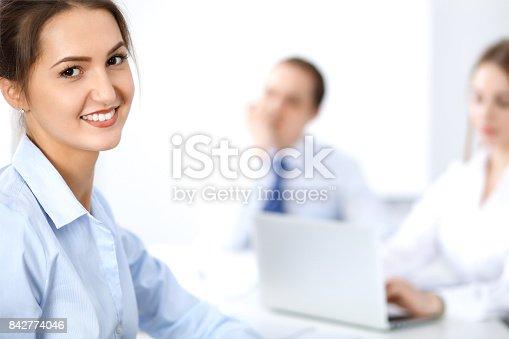 istock Beautiful business woman at meeting 842774046