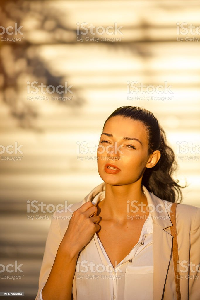Beautiful business woman at street in hot day. stock photo