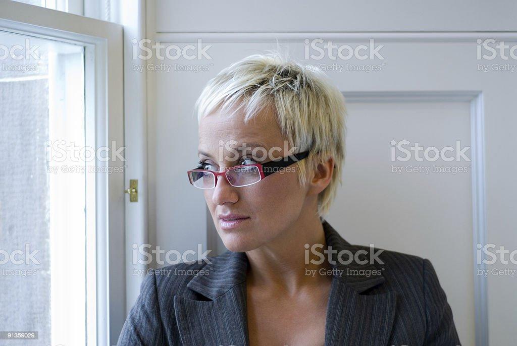Beautiful Business Woman at Window royalty-free stock photo