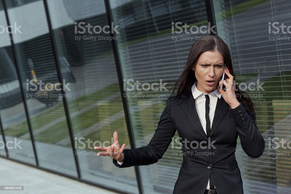 Beautiful business woman bossy on the phone stock photo