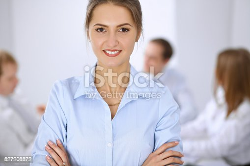 istock Beautiful business woman on the background of business people 827208872