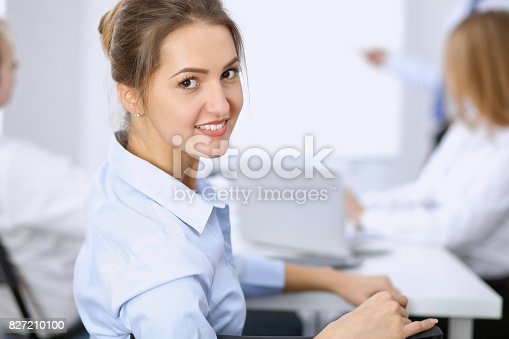 istock Beautiful business woman on the background of business people 827210100