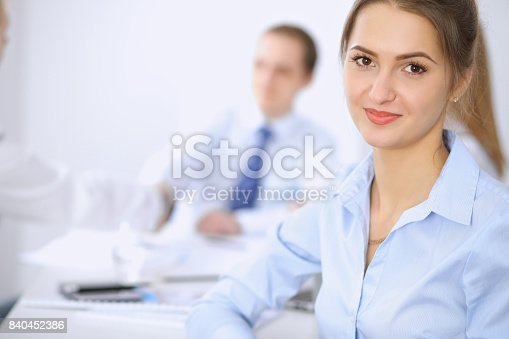 istock Beautiful business woman on the background of business people 840452386