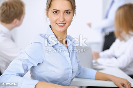 istock Beautiful business woman on the background of business people 842764794