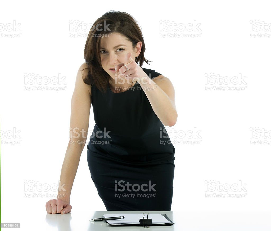 Beautiful business woman pointing at you royalty-free stock photo