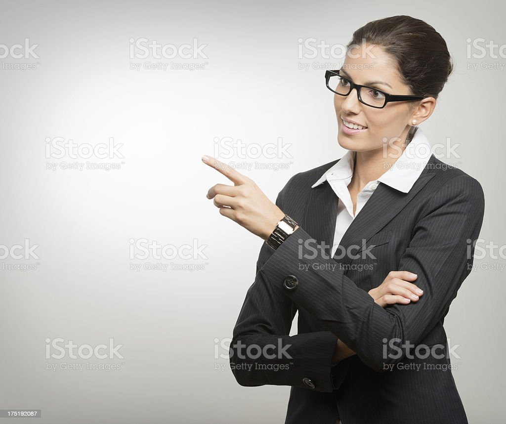 Beautiful Business Woman pointing, Copy Space (XXXL) royalty-free stock photo