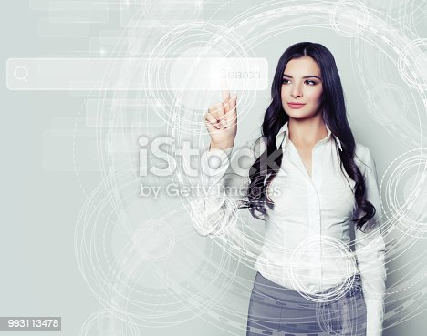 istock Beautiful business woman pointing to empty address bar in virtual web browser. Seo, internet marketing and advertising marketing concept 993113478