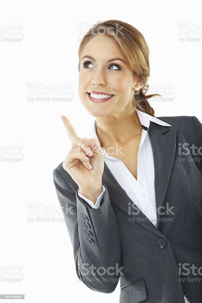 Beautiful business woman pointing upwards at copyspace stock photo