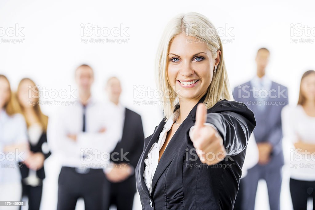 Beautiful business woman showing thumbs up. royalty-free stock photo
