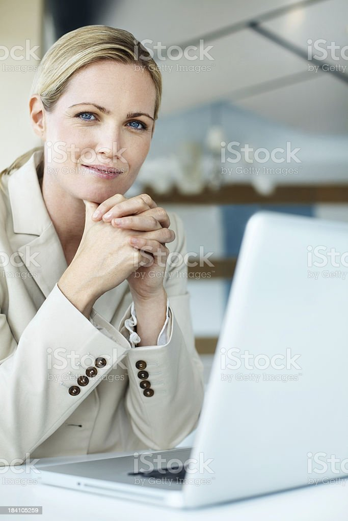 Beautiful business woman sitting by her laptop royalty-free stock photo