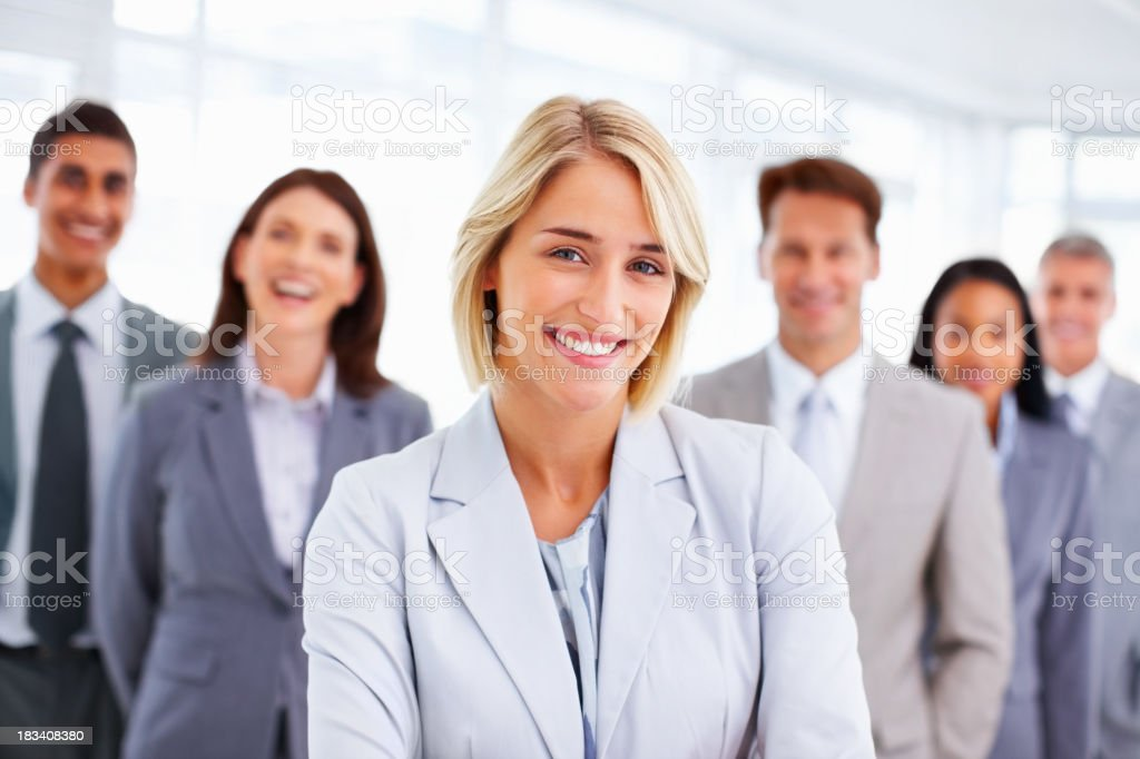 Beautiful business woman with multi ethnic executives royalty-free stock photo