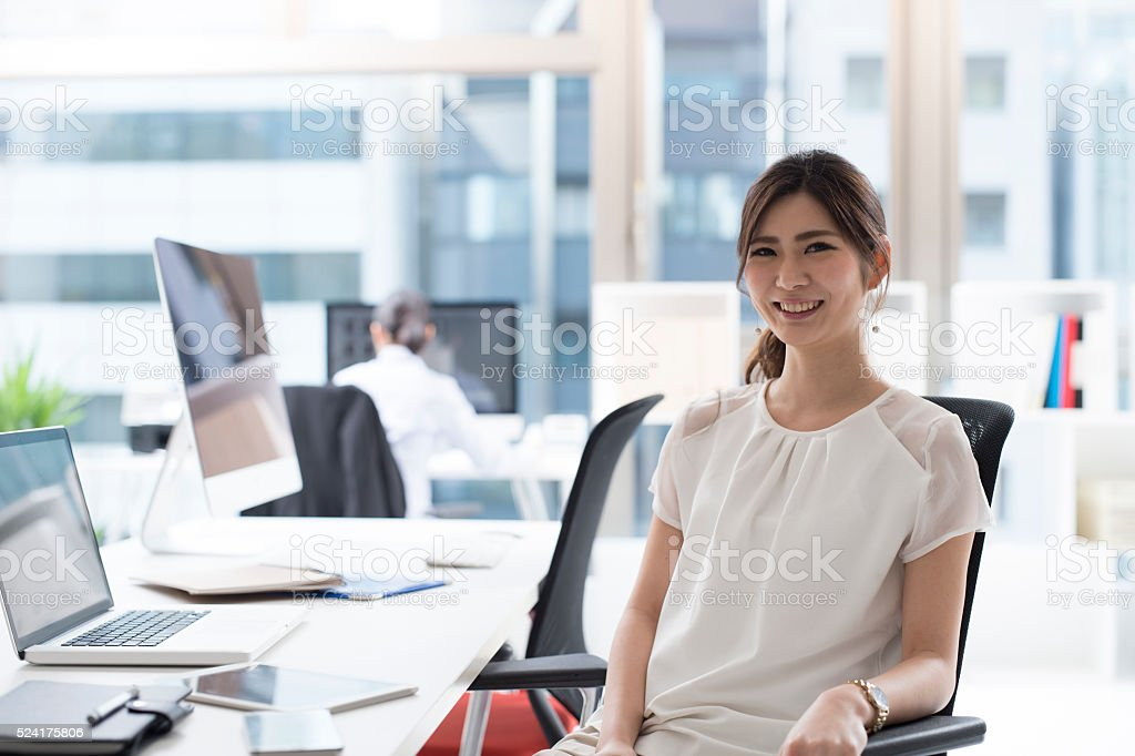 Beautiful business woman working in the office stock photo