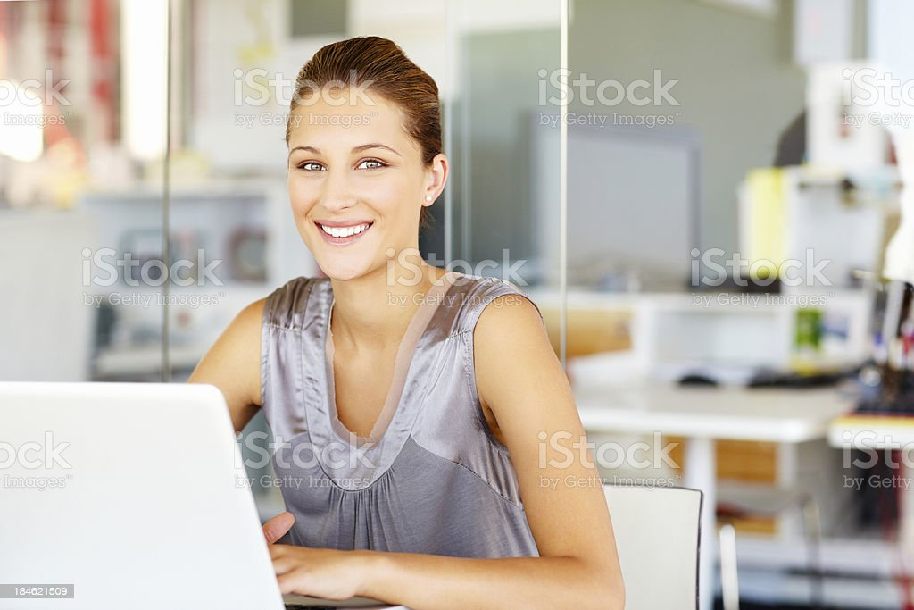 Beautiful Businesswoman at Her Desk royalty-free stock photo