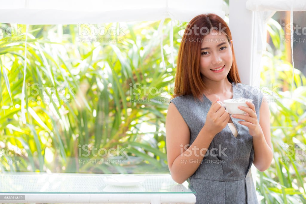 Beautiful businesswoman have enjoyed in the garden with coffee. royalty-free stock photo
