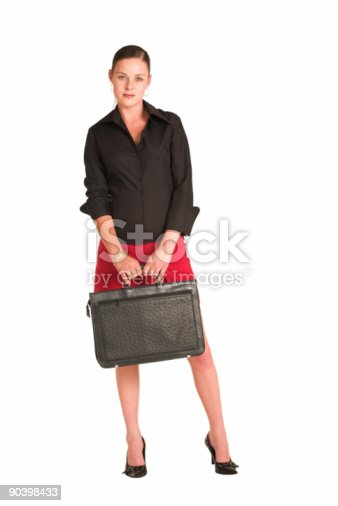 istock Beautiful businesswoman in a miniskirt with leather briefcase 90398433