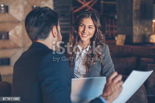 istock Beautiful businesswoman on a meeting 677611392