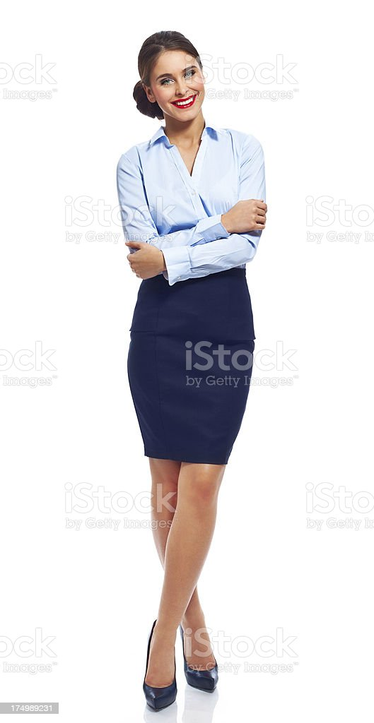 Beautiful businesswoman Full lenght portrait of confident businesswoman standing against white background with crossed arms and smiling at the camera. 20-24 Years Stock Photo