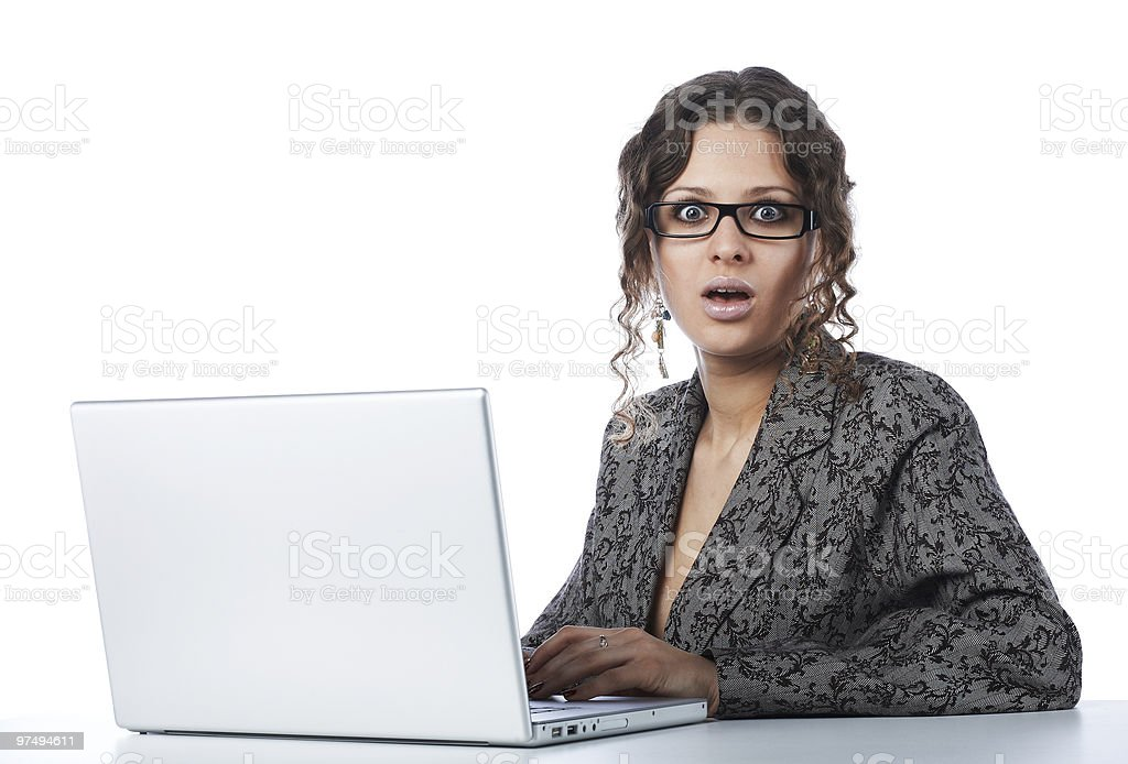 Beautiful businesswoman reading bad news at laptop royalty-free stock photo