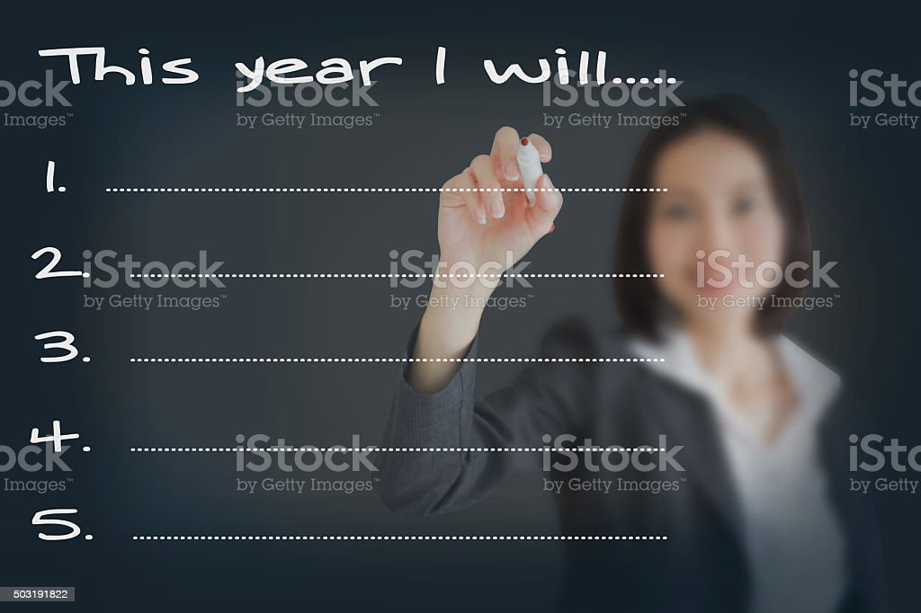 Beautiful businesswoman resolutions for 2016 / New Year Goals List stock photo