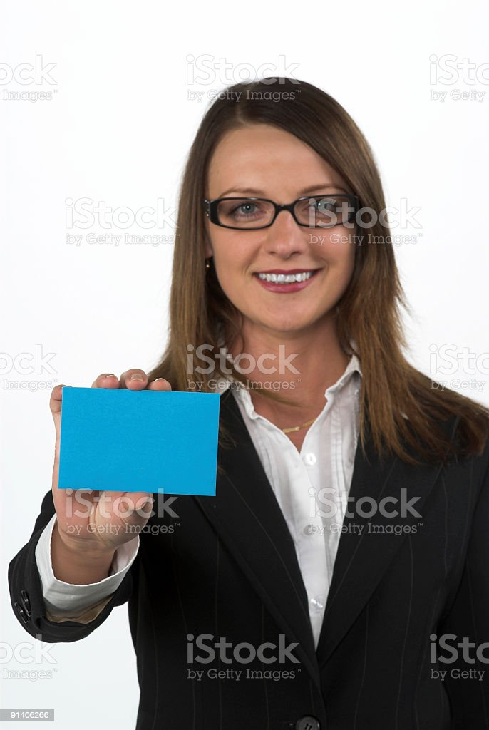 Beautiful businesswoman showing a blank paper stock photo