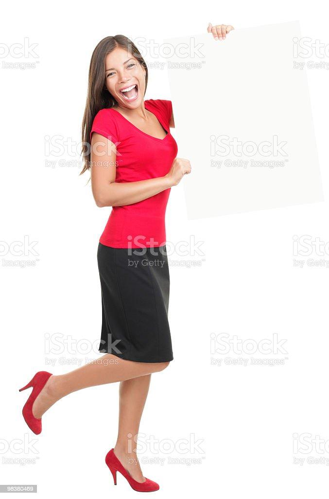 Beautiful businesswoman showing empty white board royalty-free stock photo
