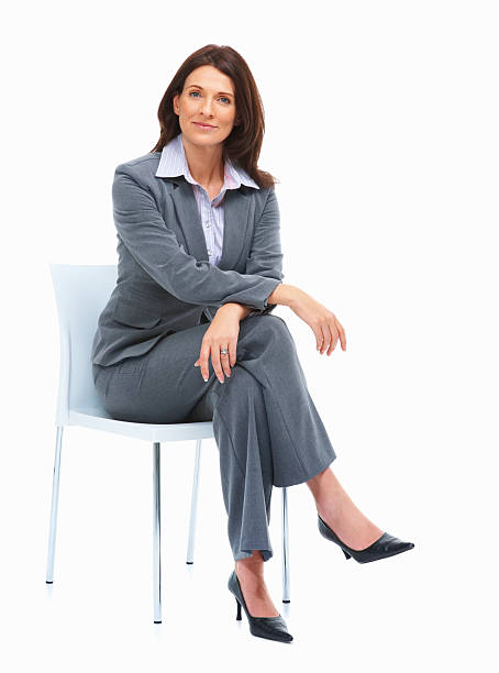 beautiful businesswoman sitting on a chair - sitting stock pictures, royalty-free photos & images