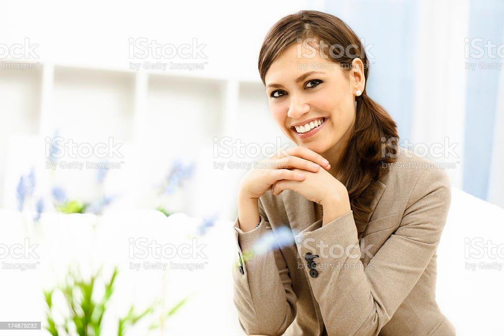 Beautiful businesswoman smiling at camera royalty-free stock photo