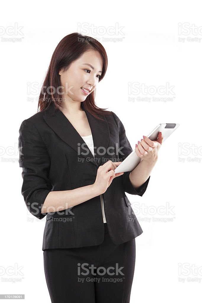 Beautiful Businesswoman Using a Tablet on White Background royalty-free stock photo