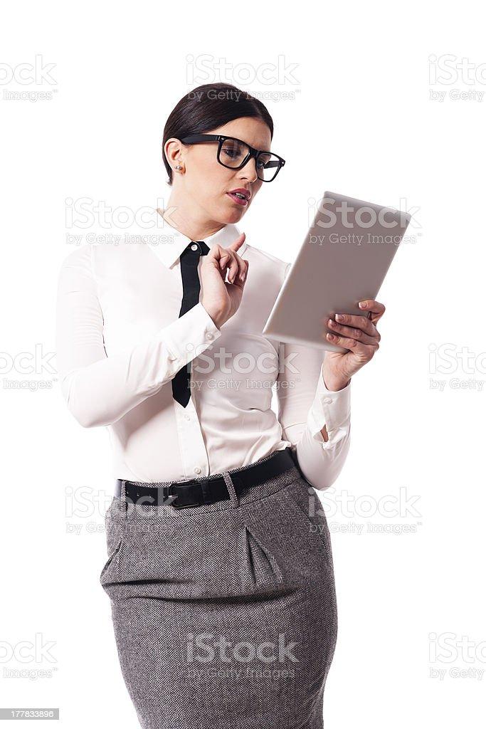 Beautiful businesswoman using digital tablet royalty-free stock photo
