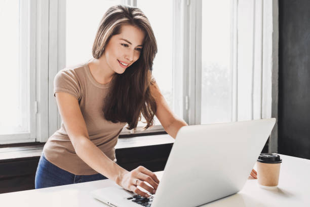 Beautiful businesswoman using laptop computer stock photo