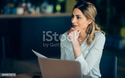 istock Beautiful businesswoman with laptop 940923370
