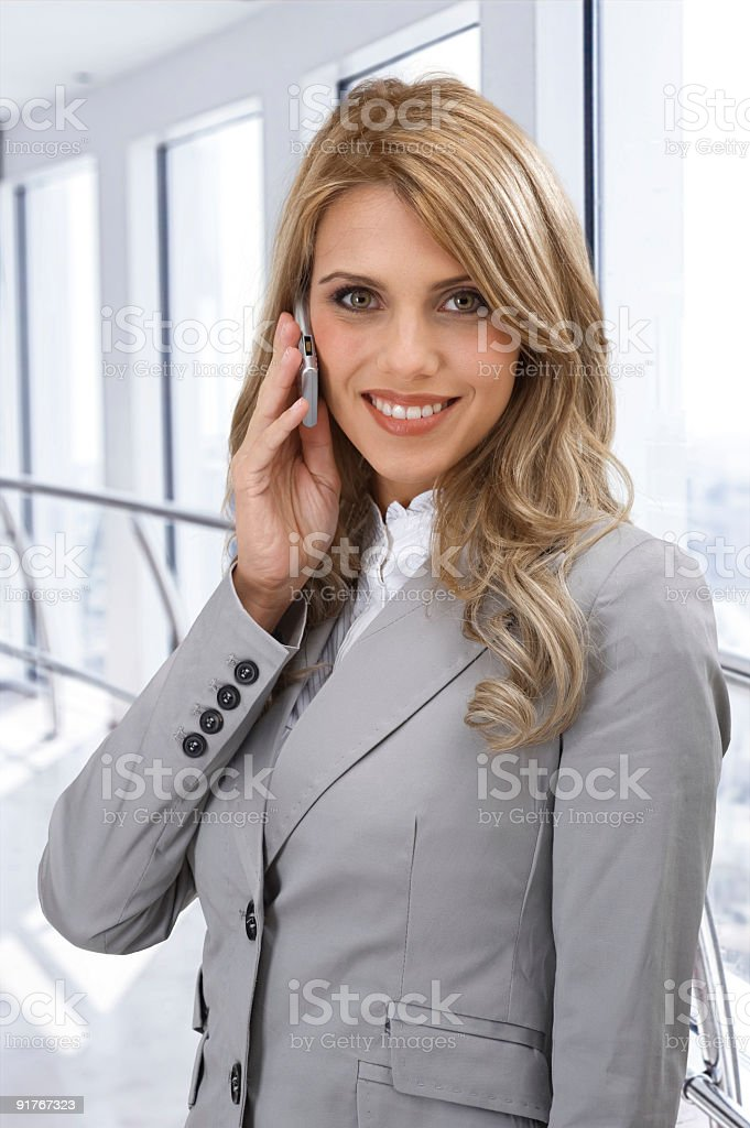 Beautiful businesswoman with mobile phone stock photo