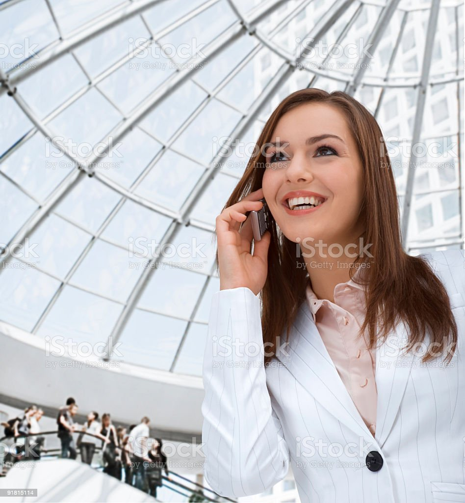 Beautiful businesswoman with mobile phone royalty-free stock photo